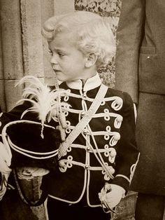 George Philip Nicholas Windsor, Earl of St Andrews, son of the Duke of Kent, as a page boy at a society wedding, 1960s