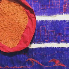"Detail from ""a deflated red HOT button"" by Ann Boles in #whatwouldbetsyrossdo - ""this flag symbolizes rapid growth urban sprawl borders delineated by walls and a fingerprint that aligns America with a noxious identity.... Betsy has the blues..."" #communityarts #textilart #fiberart #newusflag #artxchangegallery"