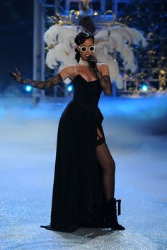 Rihanna Corset Dress - Rihanna looked dynamite on the V Secret runway in this black bustier gown with a hip-high slit.