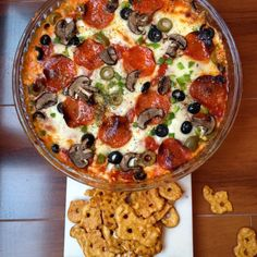 Supreme Pizza Dip 1 8 oz package cream cheese - 1 small jar marinara sauce 1/2 cup thinly sliced mushrooms (I used baby bellas) 1/2 cup chopped green bell pepper - 1/4 sliced black olives 1/4 cup sliced green Spanish olives - pepperoni - 1 cup shredded mozzarella - sliced fresh mozzarella - Italian seasoning - crushed red pepper flakes