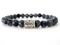 Awesome men's beaded stretch bracelet featuring 8mm snowflake obsidian beads and a pewter focal bead. The patterns in the obsidian beads is so cool and helps add to the uniqueness of this men's bracelet. These beads were hand cut so expect some slight imperfections in size and shape. Add this hip bracelet to your accessory collection!
