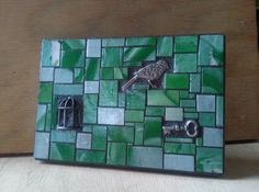 Green and white mosaic with bird and cage by velvetbearmosaics