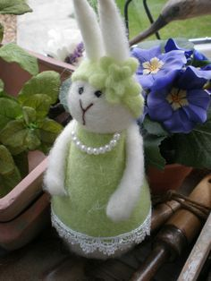 EASTER -MEDIUM SIZE EASTER BUNNY WEARING PEARLS AND A LIME GRREN DRESS WITH MATCHING HEAD BAND £ 4.99 ONLY 10 AVAILABLE....