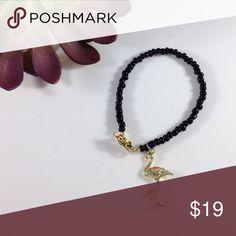 NEW flamingo charm bracelet Glass and gold flamingo charm never worn new KatDJewelry Jewelry Bracelets