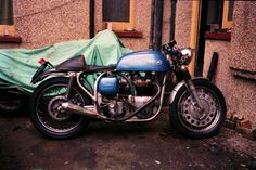 """JXD in its third stage. the tyres have been replaced with Metzlers. Other additions being the bacon slicers on the front, and a ropey """"FiGlas"""" seat, held on with an innertube. Strangely, the TLS brake has vanished, but luckily a headlamp peak has appeared."""