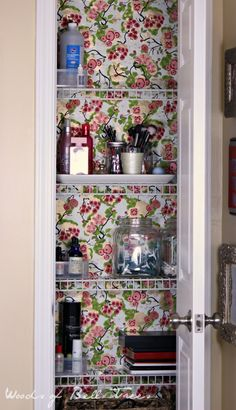 organizing a tiny bathroom closet, wallpaper, wrapping paper, new use,