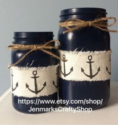 Set 2 Navy Blue painted mason jars embellished with Anchor ribbon and jute twine. Set includes 1 pin Set 2 Navy Blue painted mason jars embellished with Anchor ribbon and jute twine. Mason Jar Projects, Mason Jar Crafts, Mason Jar Diy, Diy Projects, Diy Mason Jar Lights, Bottles And Jars, Glass Jars, Perfume Bottles, Jar Art