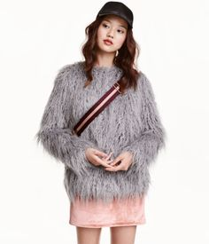 Gray. Collarless faux fur jacket with a round neck, hook-and-eye fasteners at front, and satin lining.