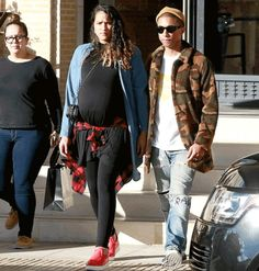 Pharrell Williams and his very pregnant wife step out in LA (photo) - http://www.thelivefeeds.com/pharrell-williams-and-his-very-pregnant-wife-step-out-in-la-photo/
