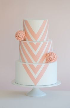 White fondant with modern interpretation of chevron. Deep blush pink with sugar flower pomander ball. Photo by Brooke Allison Photo.