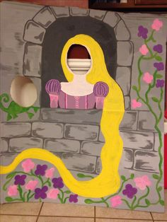 Rapunzel party photo booth. Large hand painted cardboard with holes cut out.