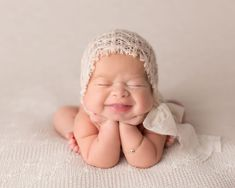 When I first started doing Newborn Photography, I noticed that when I was doing a normal newborn session, the baby would occasionally let out these huge grins – so infectious and heart melting! Nowadays, I have learned to recognize the little signs that a baby is about to let out a smile and I sit there ready with the camera to catch it!
