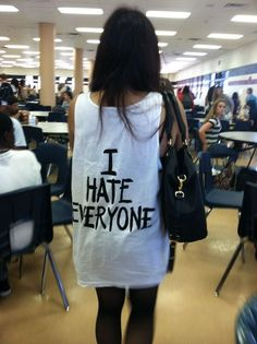 Girl Wearing I HATE EVERYONE Tank Top by Jac Vanek - Black Text on White; $39 (which dropped down to $29 before selling out)