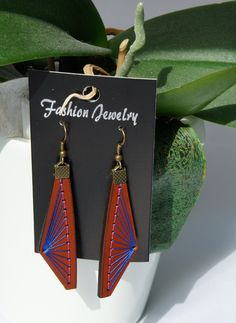 Leather Earrings Handstitch Pink and Blue. £15,00, via Etsy.
