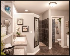 walk in grey shower with a mirror on the outside. Private shower in the master bath.
