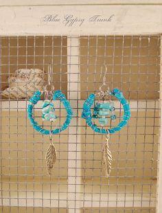 Blue/Turquoise Dangle Earrings by Bluegypsytrunk on Etsy   Super cute earrings. Reminds me of little dream catchers.