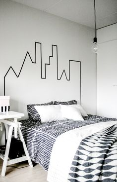 20 Lovely DIY Headboard Ideas: Washi tape city scape headboard.
