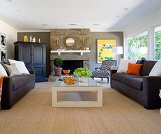 "Better Homes and Gardens Real-Home Makeover: Ranch Home Redo Cozy Living | http://www.bhg.com/home-improvement/remodeling/before-and-after/ranch-home-makeover/#page=4 | ""In the living room, they replaced a series of metal-clad casement windows with picture windows. Windows integrate the yard into the house, which makes the room seem much bigger."""