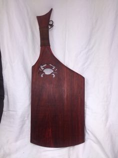 Latest creation. Padouk cutting board with crab cut out and leather wrapped handle...