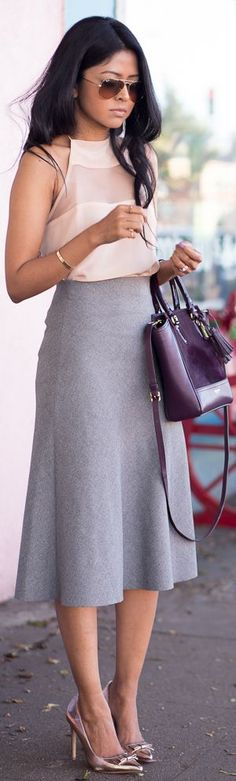 Spring / summer + sleeveless pink sheer pattern top + gray a line midi skirt + metallic stilettos