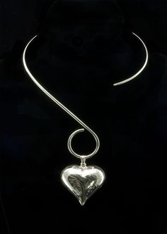 "Sterling Silver Heart Necklace  Large sterling silver puffed heart, 2""""L x 1-3/4""""W including bail. Heart is hung on a sterling silver """"S"""" shape necklace collar.    http://www.sterlingjewelrystores.com/product569.html"
