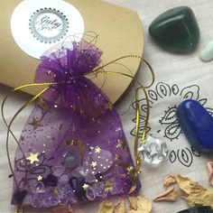 Sparkly goodies including sacred geometry Platonic solids in clear Quartz A Grade green aventurine and lapis lazuli plus a mini magic bag of gemstones for your altar and crystal grids.