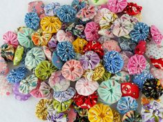 Items similar to Reproduction Fabric Flowers YoYo Bobby Pin Button 40 on Etsy Fabric Garland, Pin Button, Fabric Samples, Fabric Flowers, Bobby Pins, Quilts, Sewing, Unique Jewelry, 1930s