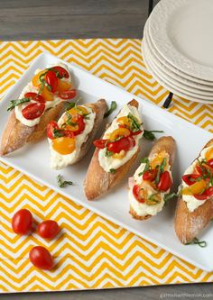 Crostini with Whipped Feta and Tomatoes served on Town House crackers is the perfect, go-to appetizer for last minute gatherings with friends. Try this recipe at your next book club or crafting get-together!