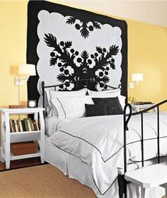 """Decorating Tricks for Your Bedroom DIY Artwork: Hanging a graphic quilt is an easy solution to the """"big blank wall"""" issue. Complementary bed linens pull the decor together. Home Bedroom, Bedroom Wall, Bedroom Furniture, Bedroom Decor, Bedroom Ideas, Bedroom Makeovers, Wall Decor, Wall Art, Bedroom Stuff"""