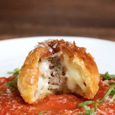 Meatball Stuffed Dough Balls - Perfect for your Super Bowl Sunday appetites!⠀ *Save this recipe on our app! Link in bio.⠀ INGREDIENTS:⠀ 1 lb ground beef⠀ ½ cup breadcrumbs⠀ 1 egg⠀ Salt and pepper⠀ ½ cup onion, minced⠀ 3 garlic cloves, minced⠀ ¼ cup parsley, chopped⠀ Thawed puff pastry, cut into 4-inch squares⠀ Shredded mozzarella⠀ Egg wash⠀ Tomato sauce⠀ Basil as garnish⠀ Grated Parmesan as garnish⠀ STEPS:⠀ In a large mixing bowl, combine ground beef, breadcrumbs, egg, salt and pepper…