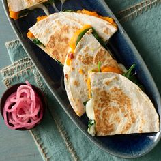 Sweet Potato & Spinach Quesadillas  2 medium sweet potatoes (1 pound total)  1 cup red-wine vinegar  1/2 cup sugar  4 black peppercorns  1 large red onion, sliced  1/4 teaspoon kosher salt  1/4 teaspoon freshly ground black pepper  8 (6-inch) flour tortillas  5 cups baby spinach (about 4 ounces)  1 cup shredded part-skim mozzarella  4 teaspoons olive oil