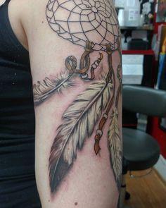 Native feather tattoos via