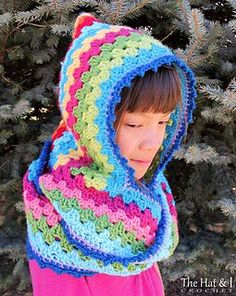 Ever wanted to wear your granny stripes? This colorful hood with cowl is designed to brighten any winter wardrobe…stay warm, look fab!