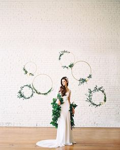 Hanging on by a thread. A very very durable thread ;) Also, please note that around here we love to celebrate new + unusual...cue garland boa THANK YOU @ashleybosnick for freezing this moment in time for us + @oneeleveneast for being the perfect backdrop for our installs! xx always