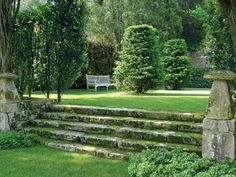 Gorgeous wide stone steps neatly transition between lawns