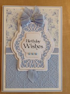 Chic floral paper pad and stamp by Phill Martin and Sue Wilson's dies and embossing folder were used here