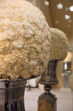 white carnation pomanders in silvered urns