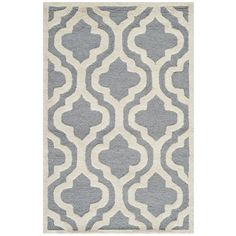Hand-tufted of a 100-percent wool pile, this handmade wool rug features a special high-low construction to add depth and unusual detailing.