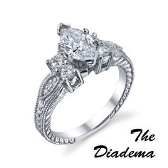 The Diadema  #MR #113-15011    The Diadema - 1.01ct marquise cut center diamond with .43cts of round brilliant cuts diamonds on the side set in 14kt white gold.  http://www.georgethompson.com/engagement-rings/the-diadema.html#