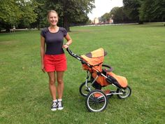 A young sporty mom with a jogging stroller
