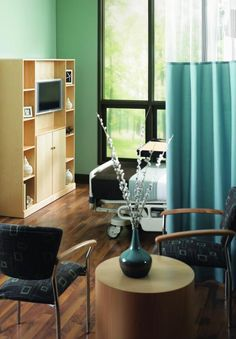 Flowers, photos, and other amenities add a personal touch to patient rooms. Photo courtesy of Business Interiors by Staples.