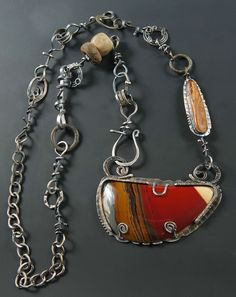 Sterling Silver, Australian Sunset Jasper, Ancient Walrus Ivory (found on the shores during the Alaskan summers), Ancient Amazonite, Ancient Celtic Money Rings. Stone setting is 4 inches across and 2 1/2 inches wide. 36 inches of chain. © Allison Bellows
