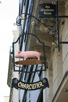 "15th arrondissement - ""Au Cochon Rose"" (The Pink Pig) at 137 rue Saint Charles.  The cutest hanging sign ever!"