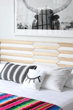 My headboard is finally up, and I LOVE it! I originally saw this pattern on a coffee table, and knew it would be the prefect backdrop for my bed. I went out and bought a miter saw for this project (be