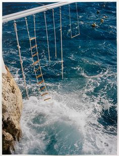 swings above the ocean in south france. This look awesome but im too chicken.. look at the wave crashing in.