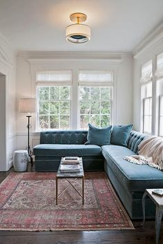 sectional bench, modern traditional, oriental rug, leather bench, white roman shades, semi flush mount, chair rail