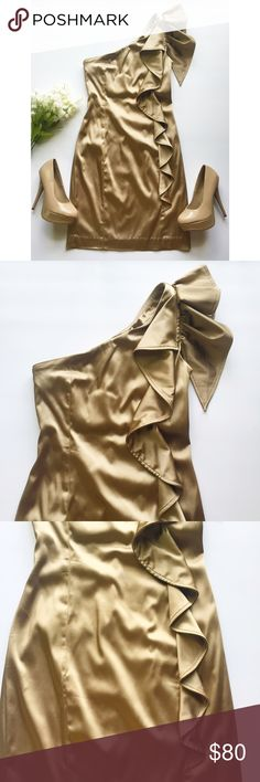 One-Shoulder Gold Cocktail Dress Worn only once & has been freshly dry cleaned • ruffles go down left side from sleeve to hip • hidden side zipper closure • 68% acetate, 29% nylon, 3% spandex • Calvin Klein gold evening dress perfect for special occasions such as dinner parties, weddings, homecoming, or sorority formal✨ • Accepting reasonable offers! Calvin Klein Dresses One Shoulder