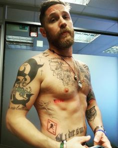 Tom Hardy - 2 new tattoos. The word 'Marlowe' & a picture of a raven. 29 September 2015.