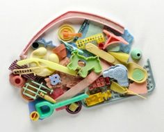 Artists Recycle Washed Up Toys on California Seashore into Beach Plastic Artwork