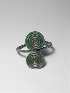 Armband with Spirals  4th–12th century B.C.   Culture: German   Medium: Copper alloy   Dimensions: Overall: 3 3/4 x 3 11/16 x 3 1/4 in. (9.5 x 9.4 x 8.3 cm)